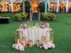 Sweetheart Table with Double-Duty Lanterns and Flowers from Wedding Ceremony