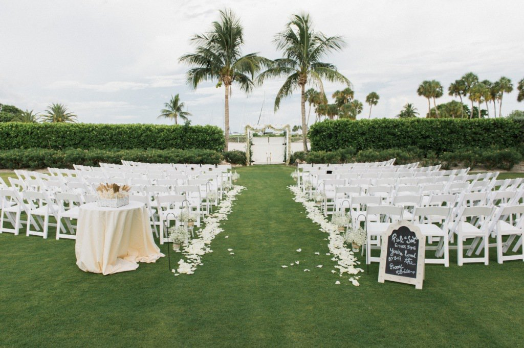 Harbourside Lawn with Rose Petals Down Wedding Aisle