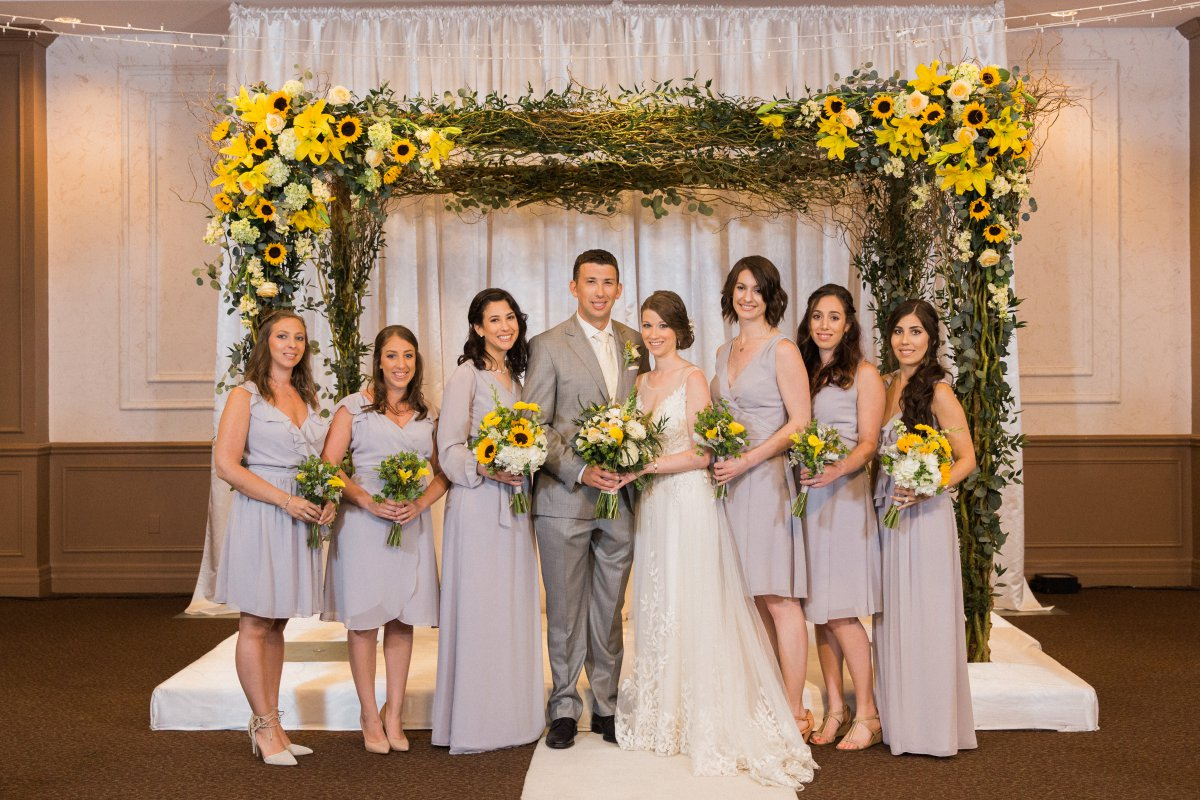 Bridal Party with Chuppah and Bouquets