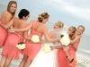 bride-and-bridesmaids-with-white-and-coral-roses