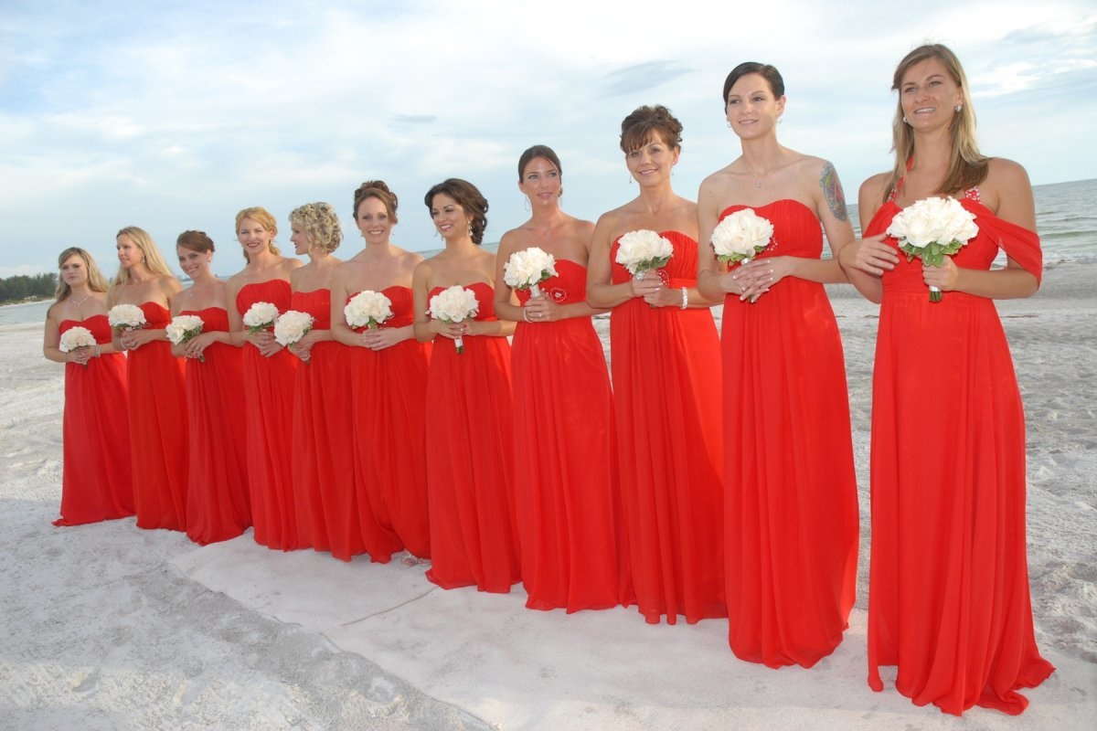 Bridesmaids In Red Dress With White Roses