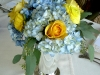 Blue Hydrangea, yellow roses, and ranunculus in a julep cup