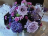 Mixed garden centerpiece in purple and lavender with touches of hot pink