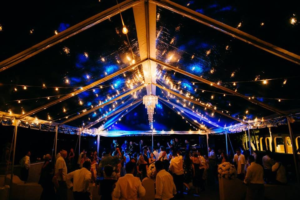 Clear Tent with Affairs in the Air Chandelier and Light Bulbs Across Loggia