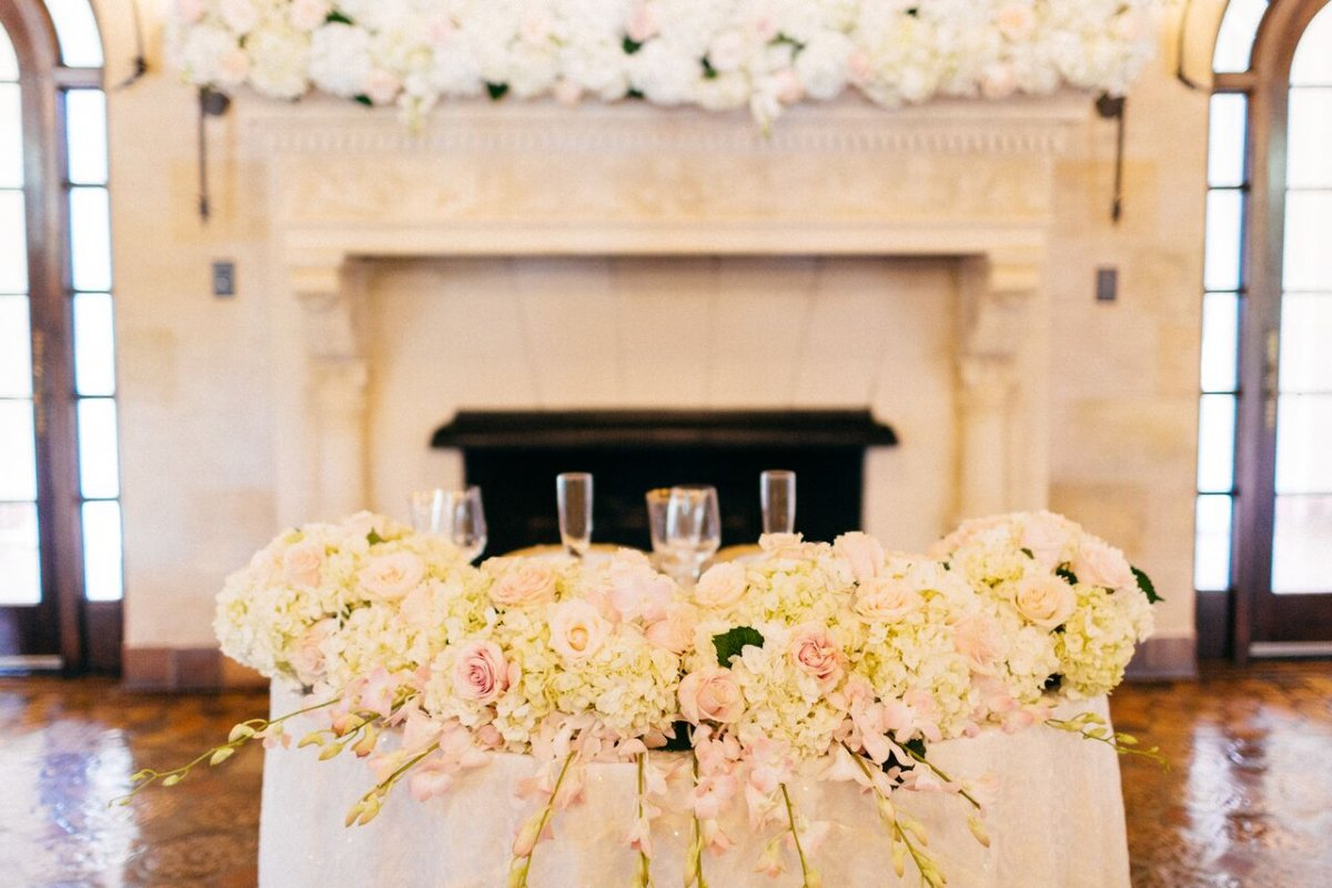 Sweetheart Table Edged in Blush, Cream Flowers which Trail Over Edge of Table