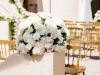 Compact Rounded Arrangement on Half-Wall of Entry Way into Loggia featuring blush and cream roses and hydrangea