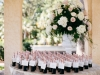 Place Card Table featuring large urn of gorgeous flowers and small bottles of champagne so cards wouldn't blow away!