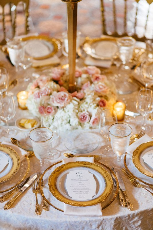 Close-up of wreath at the base of the gold candelabra guest table centerpiece