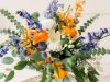 Garden-look Bridal Bouquet in Orange, Creams, and Blues