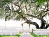 Wedding Site Under the Gazebo at Palmetto Bed and Breakfast with Orange, White Floral Sprays