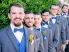 Groom with Orange Boutonniere and Groomsmen with Blue Thistle Boutonnieres
