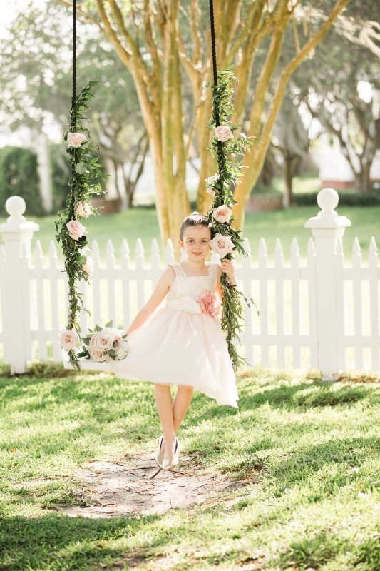 Flower Girl on Swing with Bouquet
