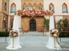 Wedding Arch with Peach and Coral Flowers Across the Top at the Ringling Museum Ca Dzan