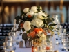 Feasting Tables with Centerpieces of Roses, Greens, and Cutie Oranges