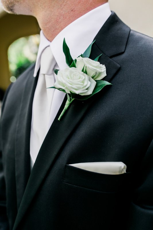 Close up of Groom's Double Spray Rose Boutinniere