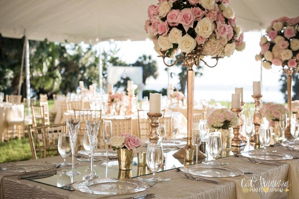 Head Table with Gold Candelabra and Flower and Candles Down Table
