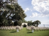 Ceremony on the Lawn at the Powel Crosley Estate with Draping and Large Floral Arrangements Back of Aisle