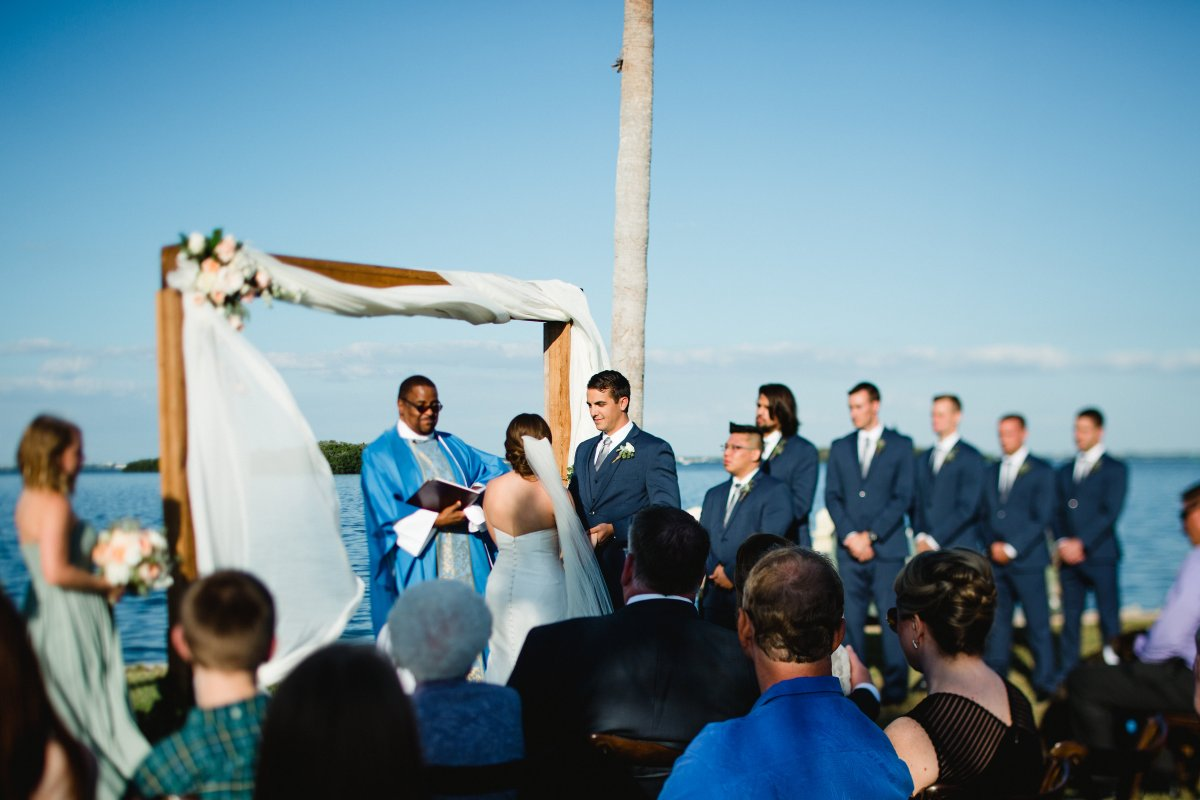 Ceremony with Cedar Arch by Water