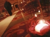 Asile lined with candles and rose petals
