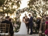 Couple Under Ceremony Arch in Ringling Courtyard with Statue of David in the Backgroun