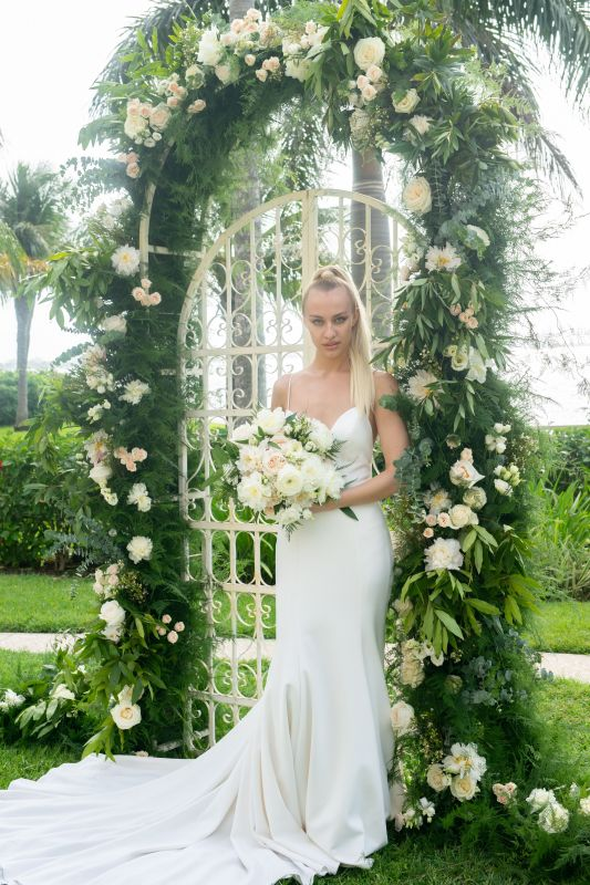 Bride with Bouquet in front of Iron Gate Decor