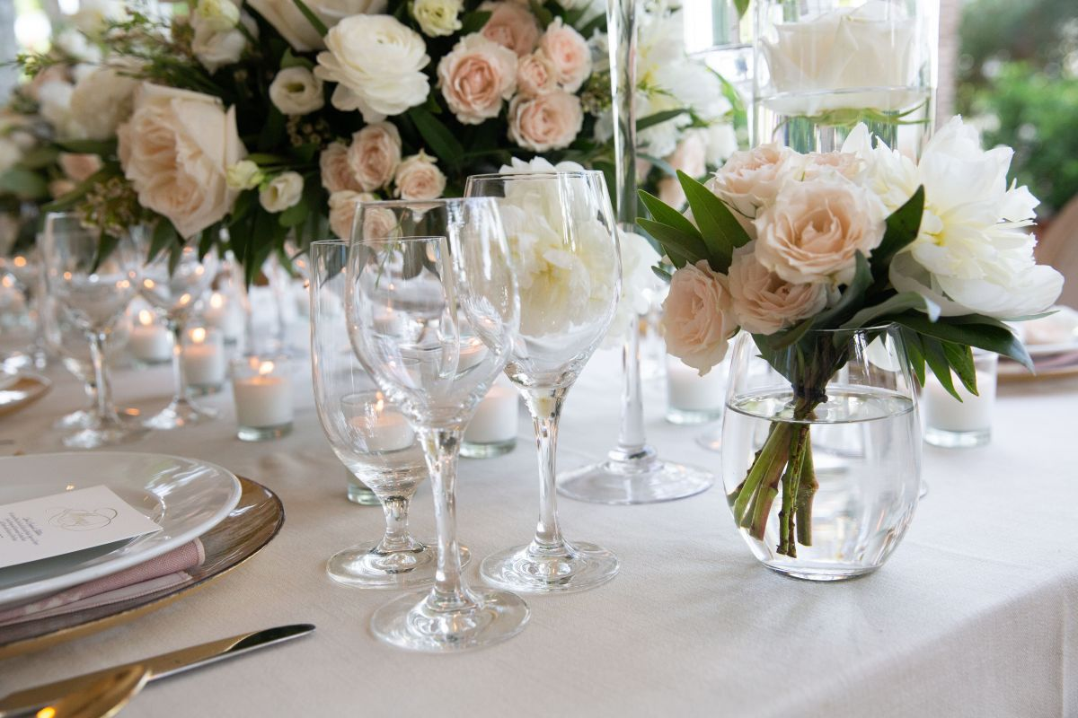 Close up of Small Floral Arrangement on Table in Blush and White