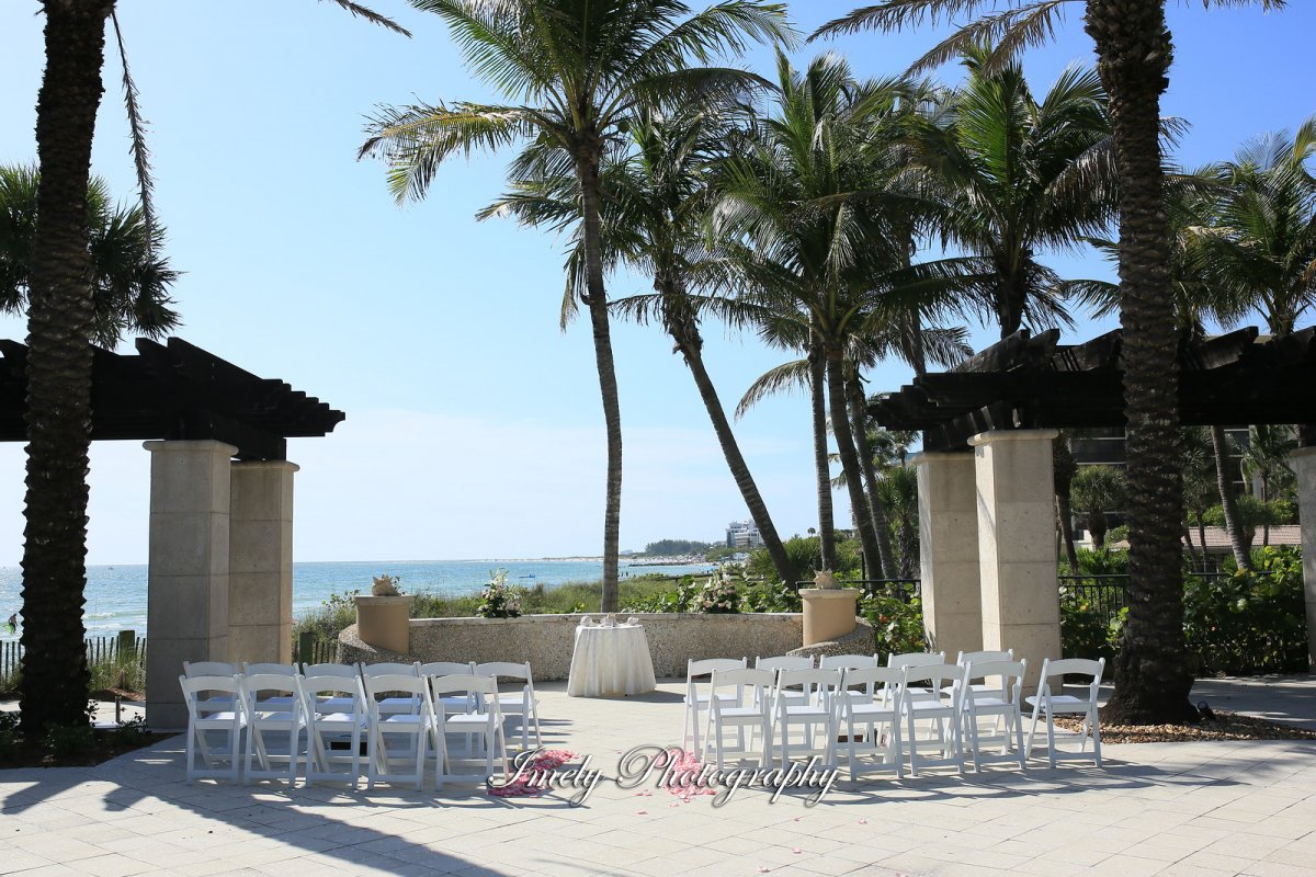 Ceremony Site with Pink Rose Petals and Small Florals Low Tides Terrace