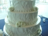 white-ranunculus on wedding cake