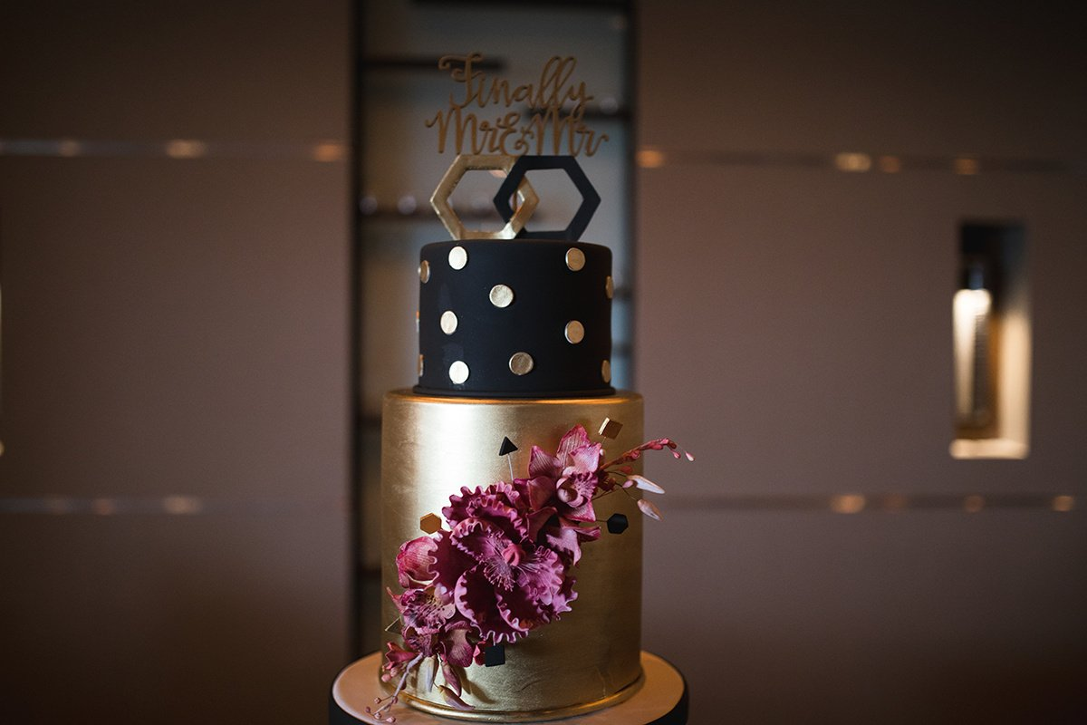 Black and Gold Wedding Cake with Flowers