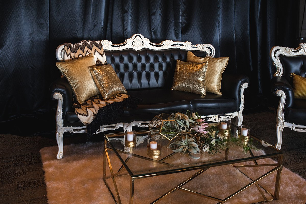Black Elegant Seating Area by So Staged with Flowers