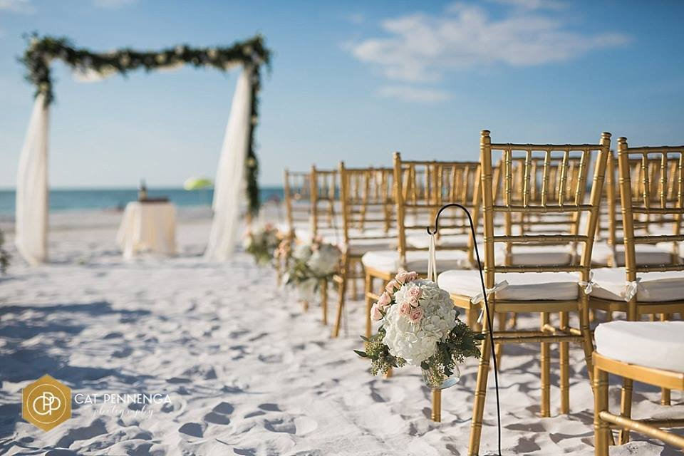 Arch with Garland and Flowers, Aisle Flowers Used Later for Centerpiece