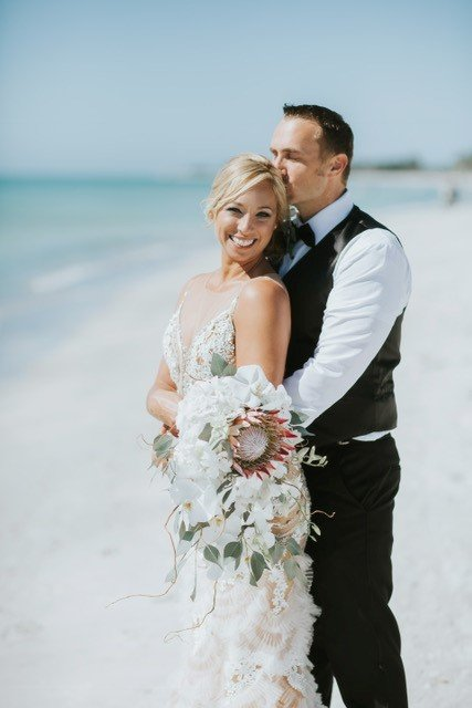 Bride with Bridal Bouquet and Groom