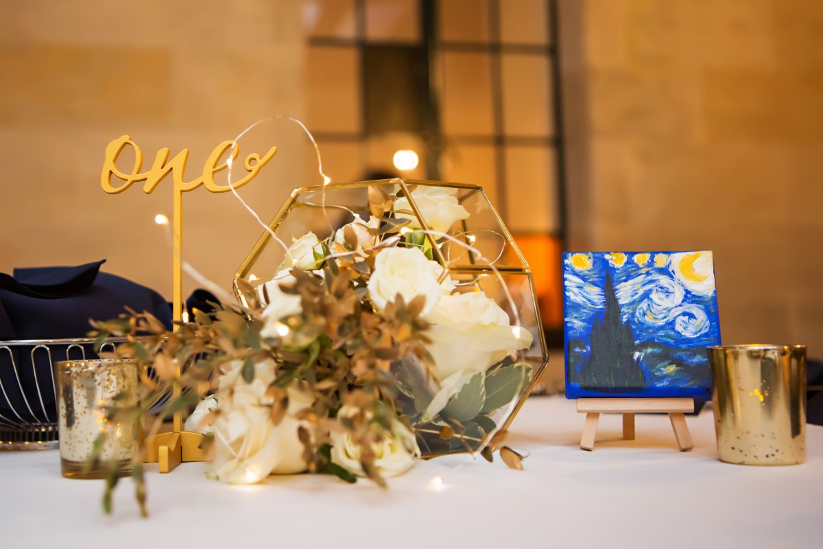Terrarium with Roses and Gold Urns on Guest Tables