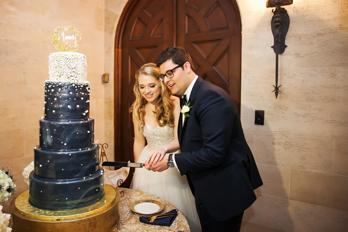 Blue and White Wedding Cake with Gold and Pearls