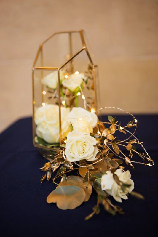 Gold Terrarium with White Spray Roses and Fairy Lights on Reception Tables