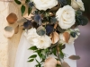 Floral Sprays on Wedding Arch with Gold Silver dollar and Roses