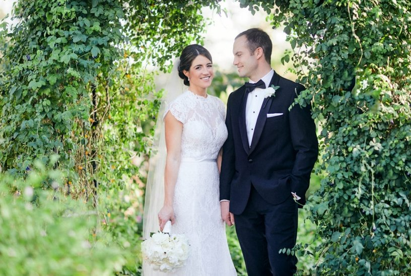 Couple with All White Bouquet with Hydrangea, Roses