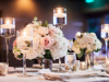 Close-Up Shot of Head Tables with Lots of Candles, Silver Bowls, and Silver Vases to Hold Bridesmaid's Bouquets
