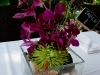 Centerpiece with sand-shells-green-fugi-purple-orchids