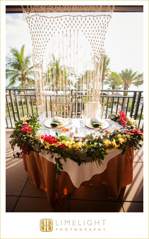 Macrame Arch Behind Sweetheart Table with Garland from Ceremony Arch