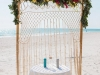 Bamboo Arch with Macrame and Garland of Tropical Leaves with