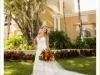 Bride with Tropical Bouquet with Red Ginger, Protea, and Orange Celosia