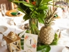 Guest Tables Composite Look with Tropical Flowers, Leaves, Gold Pineapples
