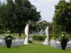lakewood-ranch-golf and country club -pergola-with-urns-aisle-flowers