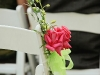 double-pink-rose-on-ends-of-chairs