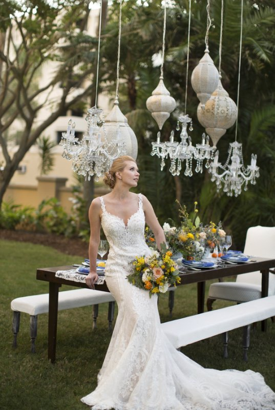 Bride with Bridal Bouquet near Feasting Table