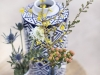 Mixed blue and white vases with assorted spring wild flowers