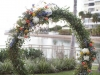 Ceremony Site with Ceremony Site natural vine standing wreath with greens and matching florals