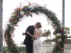 Bride and Groom at Ceremony Site near water at Ritz Carlton Sarasota