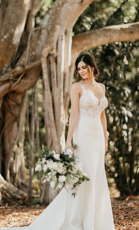 Bride Under Banyan Tree with Large Bouquet
